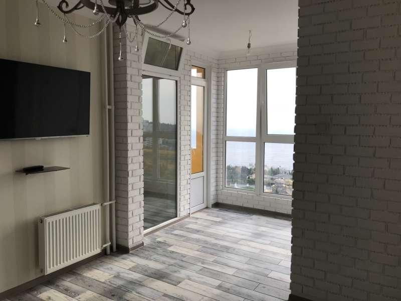 Двухкомнатная квартира в новом доме с видом на море. 4