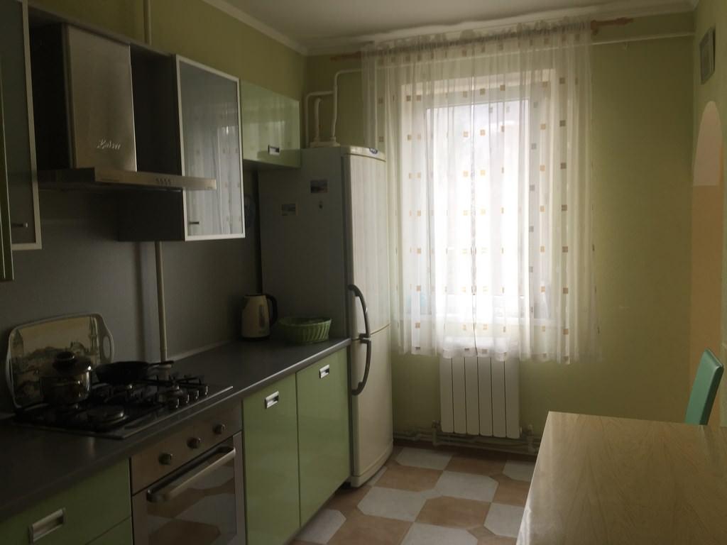 Трехкомнатная видовая квартира в жилом районе Ялты. 13