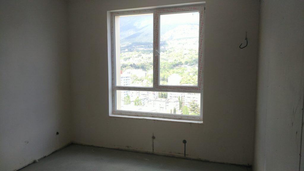 Светлая двухкомнатная квартира с видом на горы 11